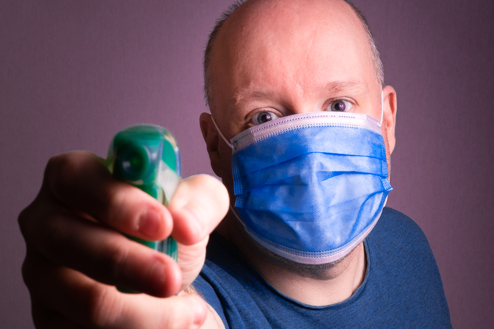 Me in a surgical mask, pointing a disinfectant spray at you!